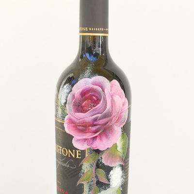 Pink roses painted on wine bottle.