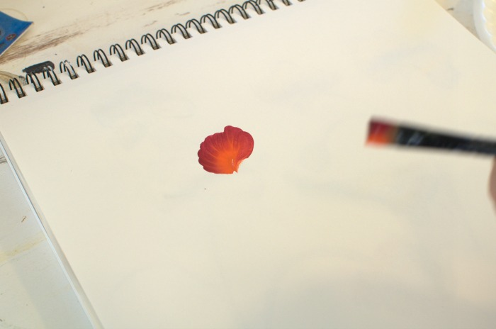 First stroke in poppy painting tutorial