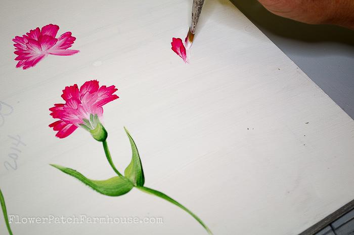 Beginning stroke of painting carnations in acrylics, pamela groppe art