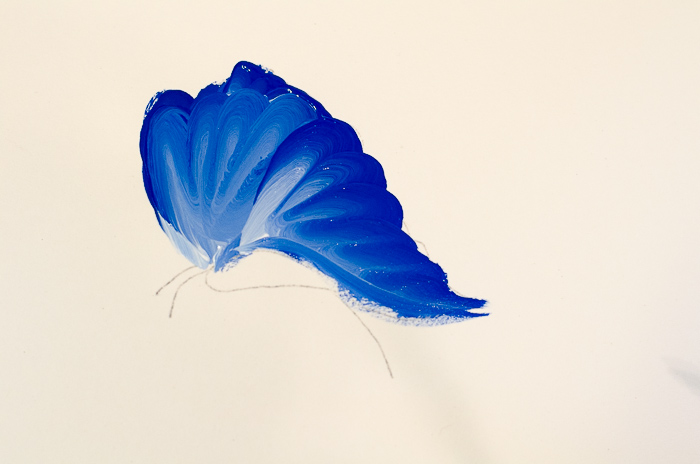 Beginning of a blue butterfly painted in acrylics, pamelagroppe.com