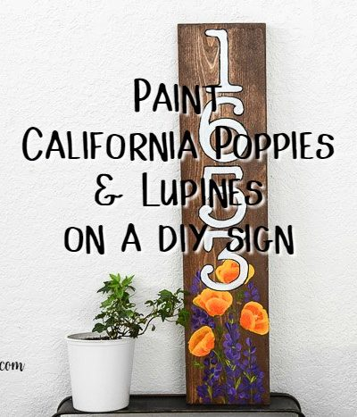 Numbers hand painted on a pine board with California Poppies and Lupines with text overlay, pamela groppe art