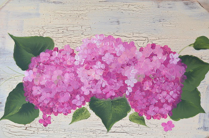 Painting of pink hydrangeas on board, petals all added